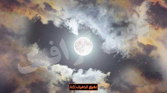 ویدیو فوتیج ماه در آسمان ابری شب