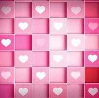 ویدیو فوتیج چرخش قلب های صورتی و سفید روی جعبه